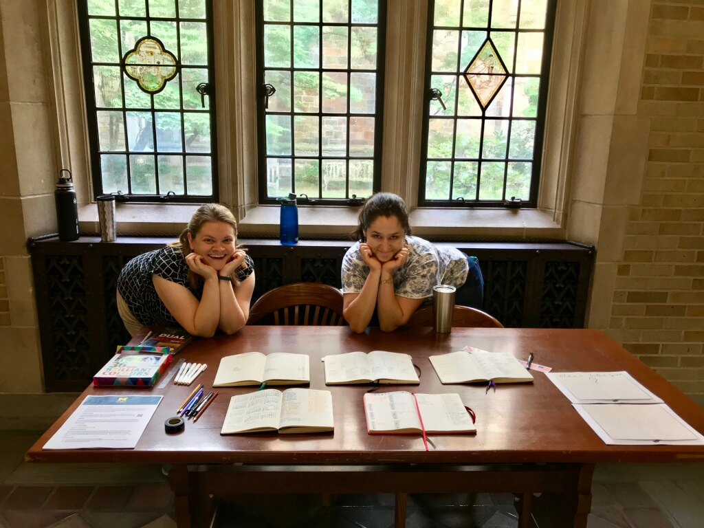 Virginia and Kate at the table with bullet journals