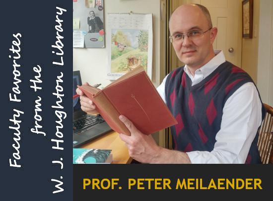 教授. Peter Meilaender拿着一本书