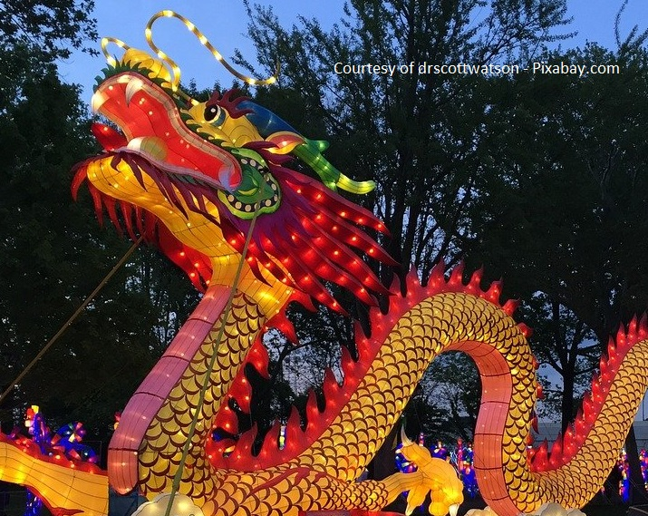 chinese dragon lit up in evening