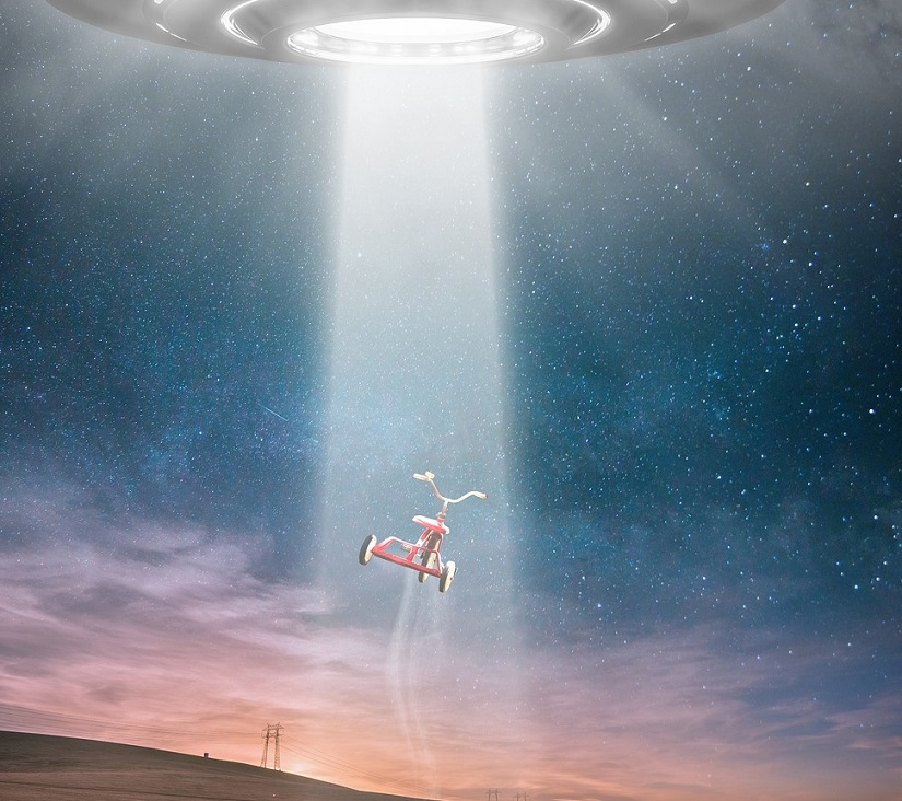 image showing ufo above pulling in a tricycle - example of graphic art
