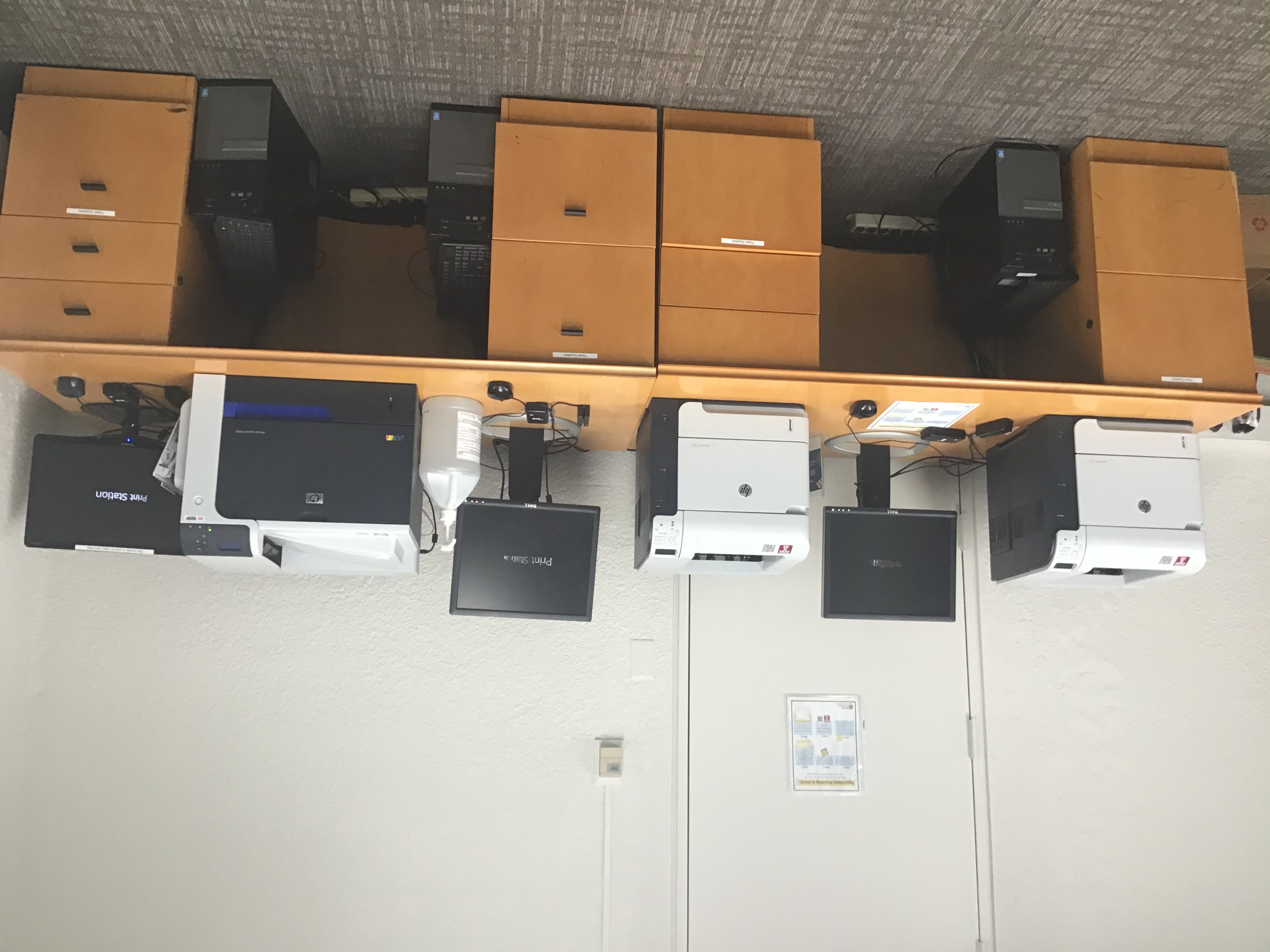 Three Printers, two are black and white, the third prints in color