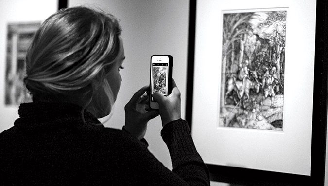 student taking photograph of Durer print
