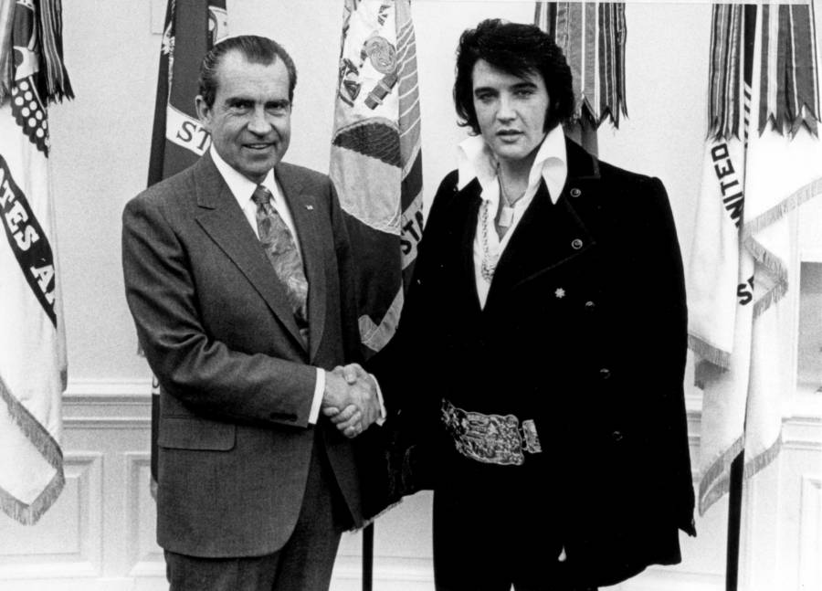 a photograph of President Richard Nixon shaking hands with Elvis Presley in the White House