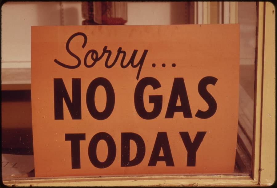 "a photograph of a sign that reads ""Sorry...no gas today"" in the window of an fill station in Oregon"