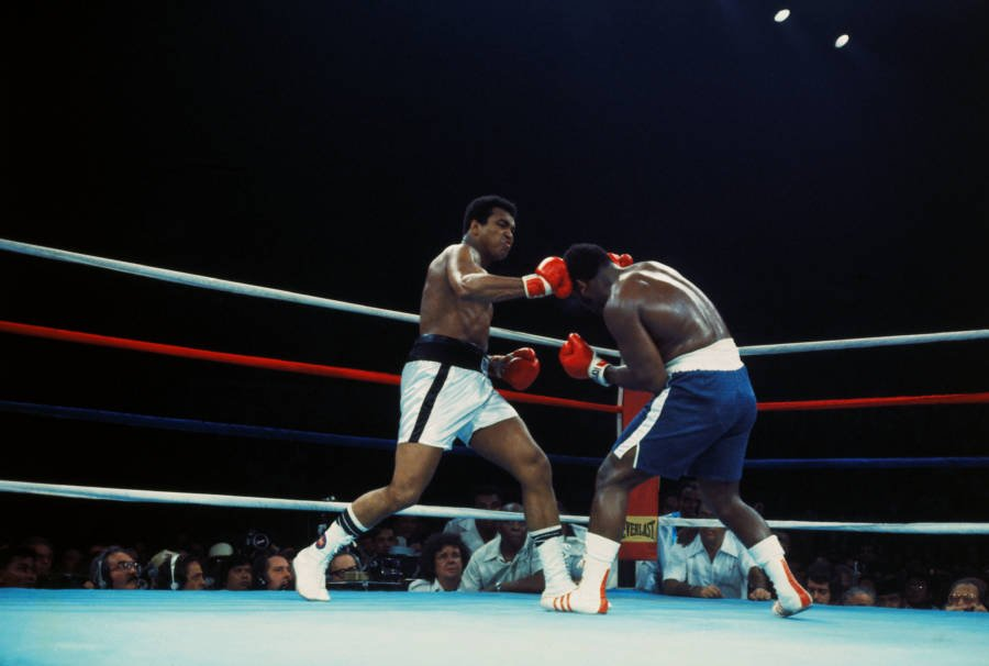 a photograph of Muhammed Ali and Joe Frasier trading blows in the boxing ring
