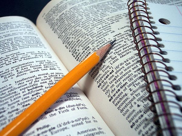 Dictionary, Notebook and Pencil