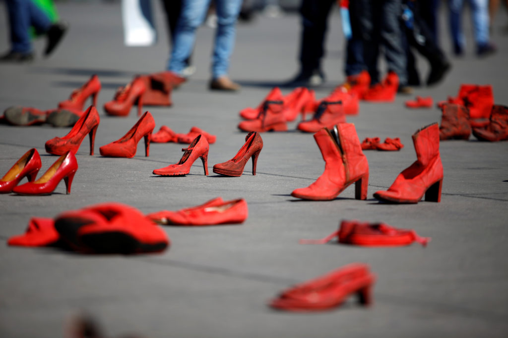 image of red shoes on public display