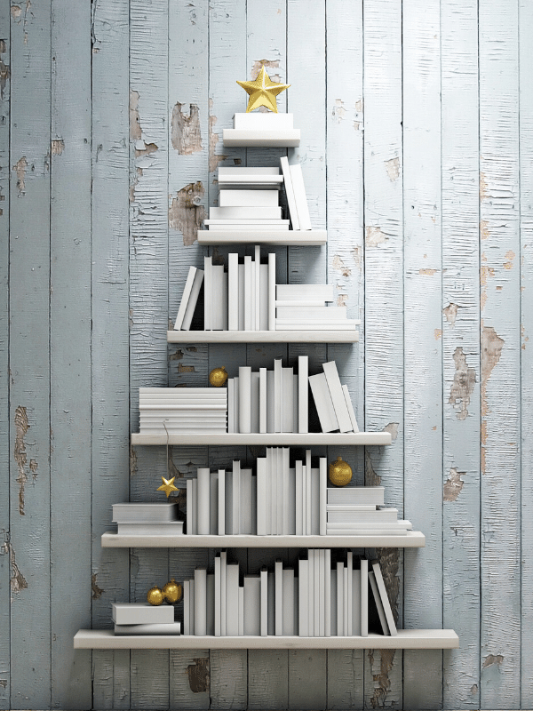 Image of Christmas tree created with book shelves on the wall. Gold accents.