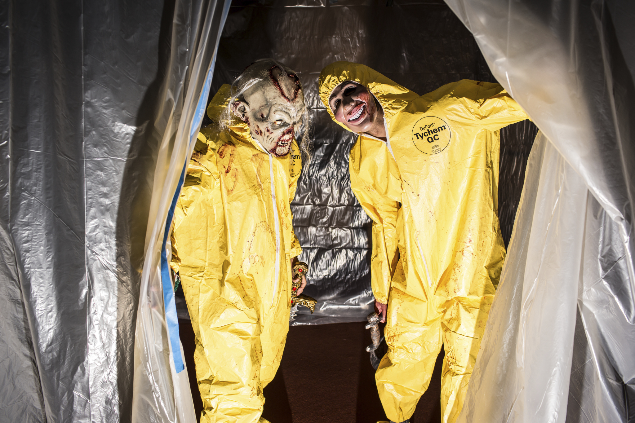Two haunted library actors in hazmat costumes