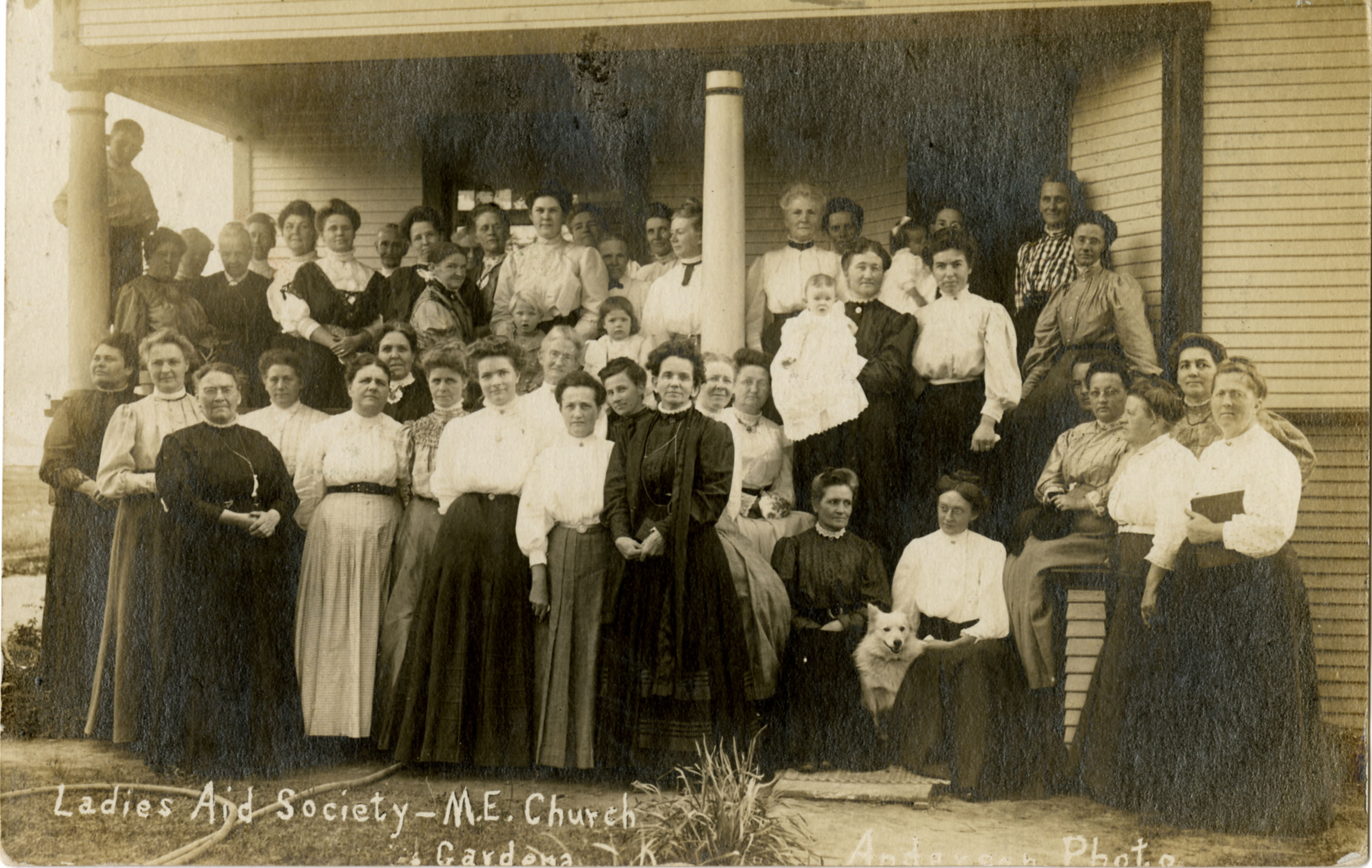 Ladies gather on steps in front of church
