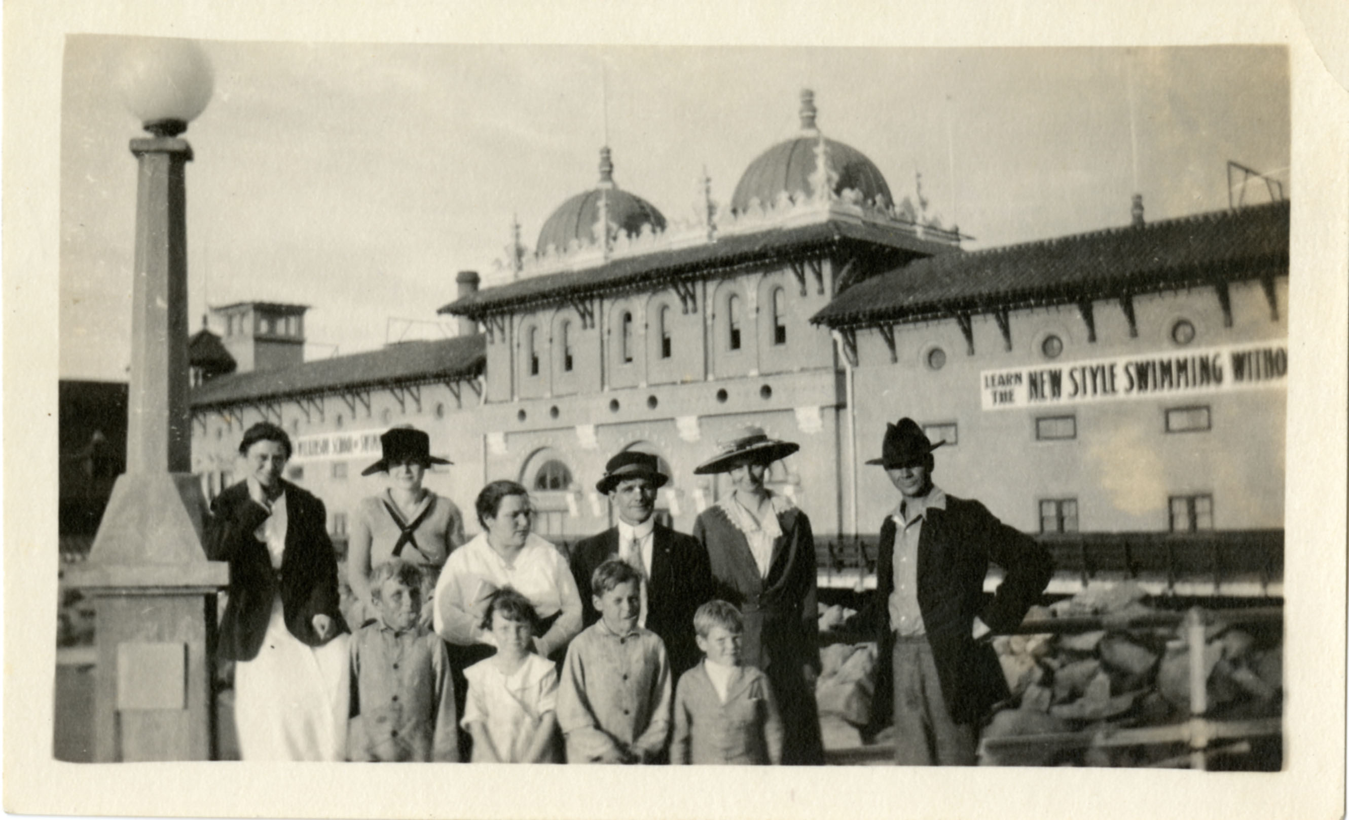 People stand in front of Redondo Beach Bath House