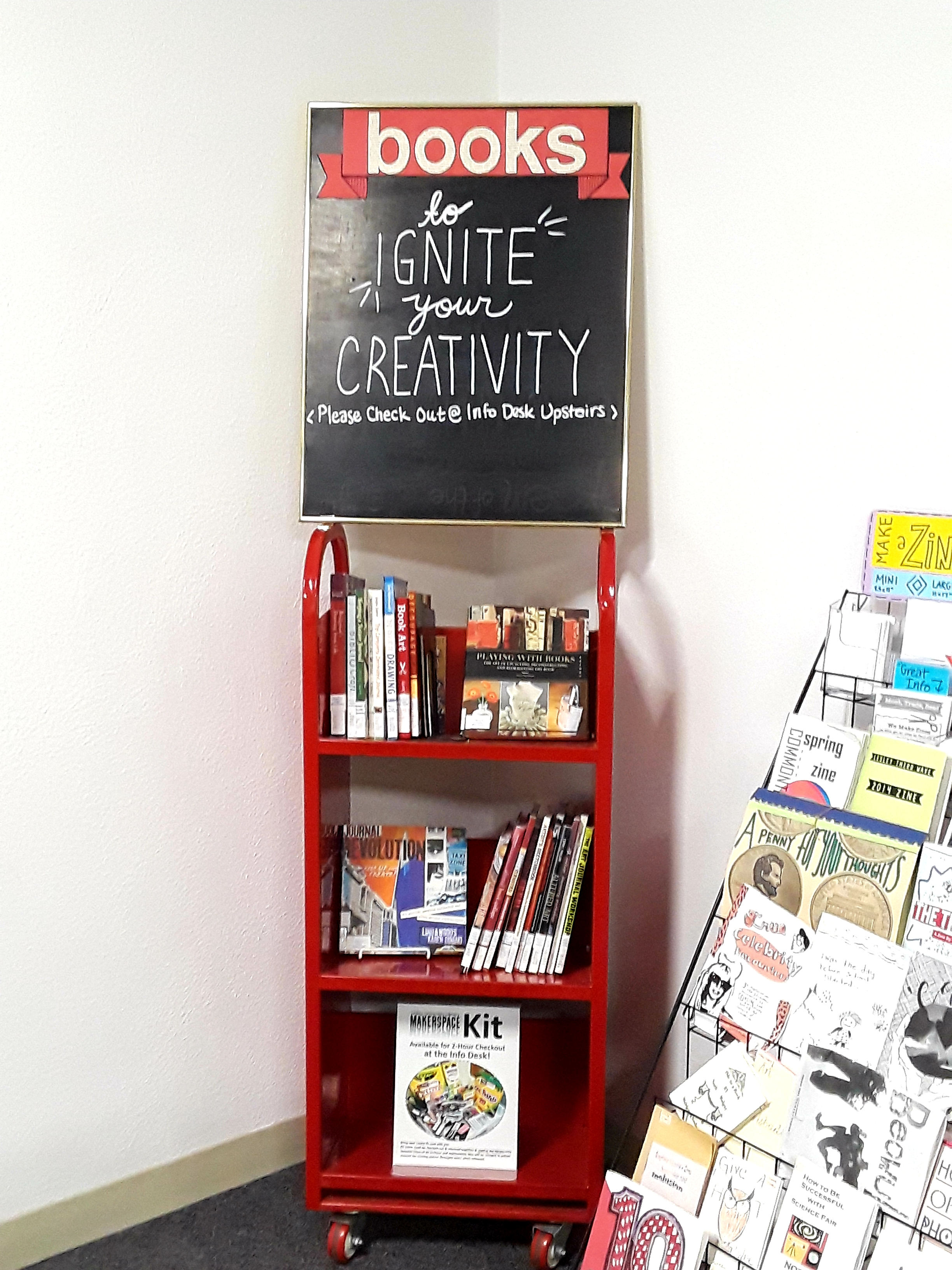 red book cart with books and a sign