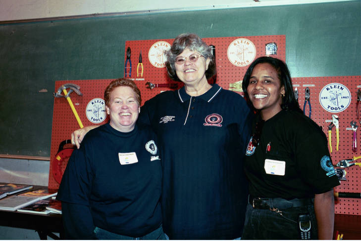 Jane Templin (center) with two other tradeswomen during Career Day at Electrical Training Trust.