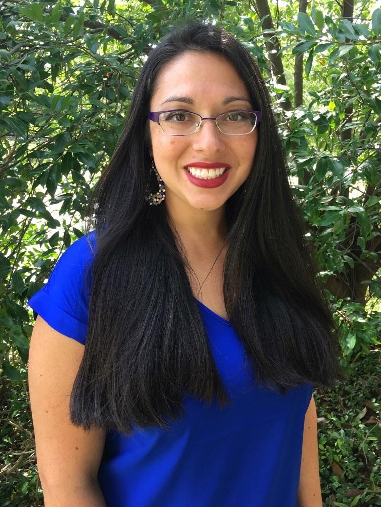 Women with long dark hair, smiling.