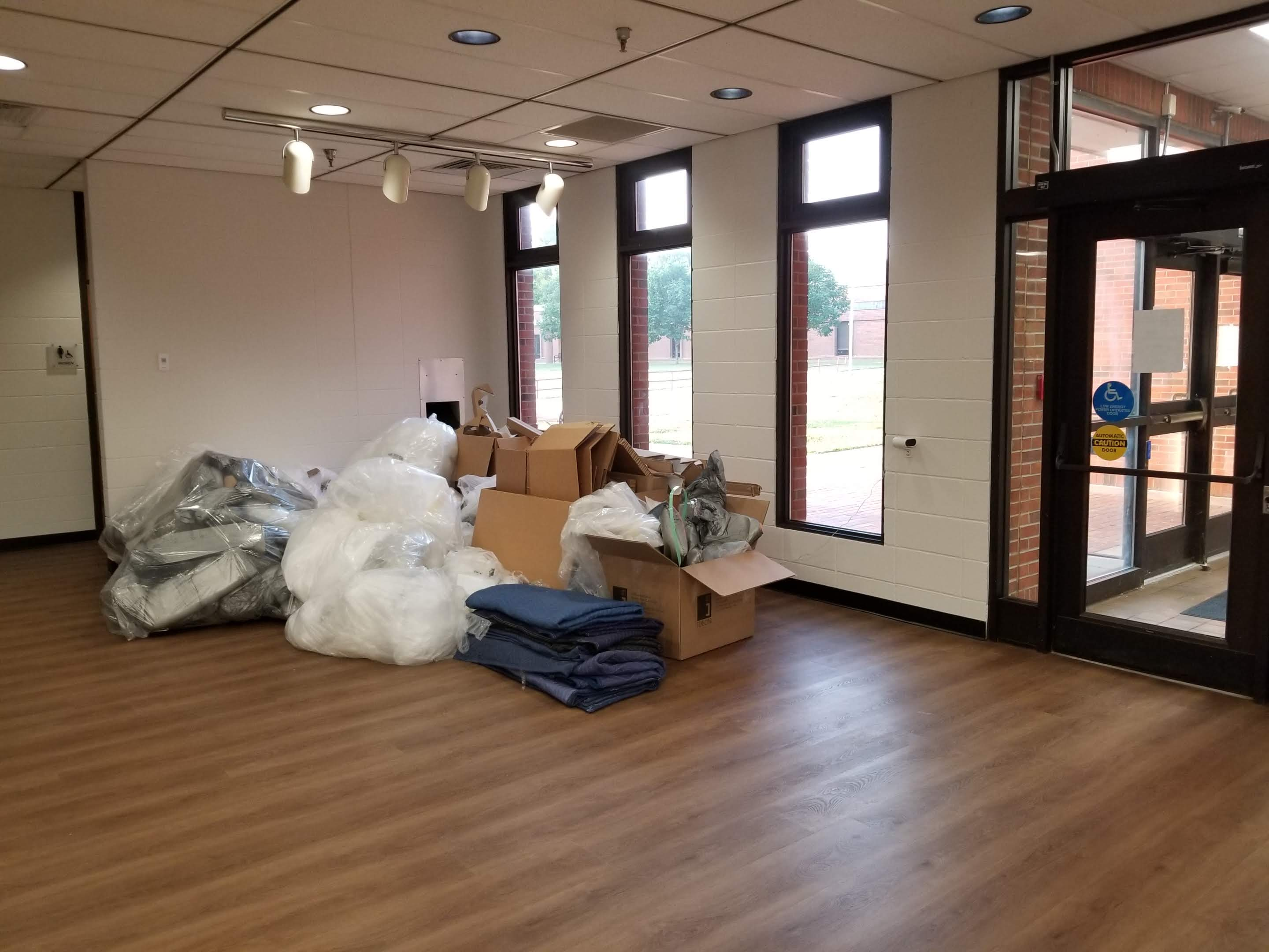 New floor and trash in empty library lobby
