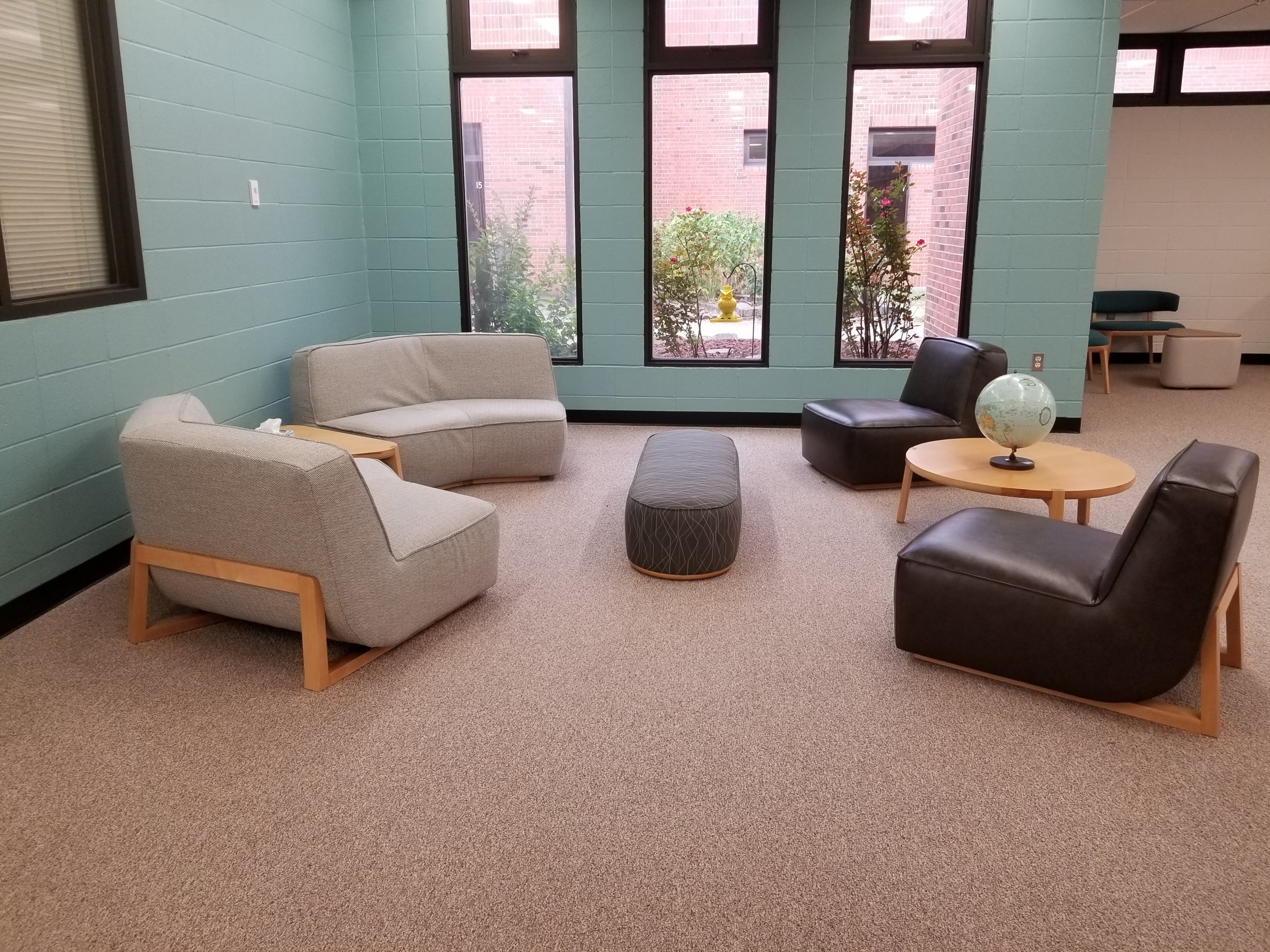 Seating area in library with view of garden