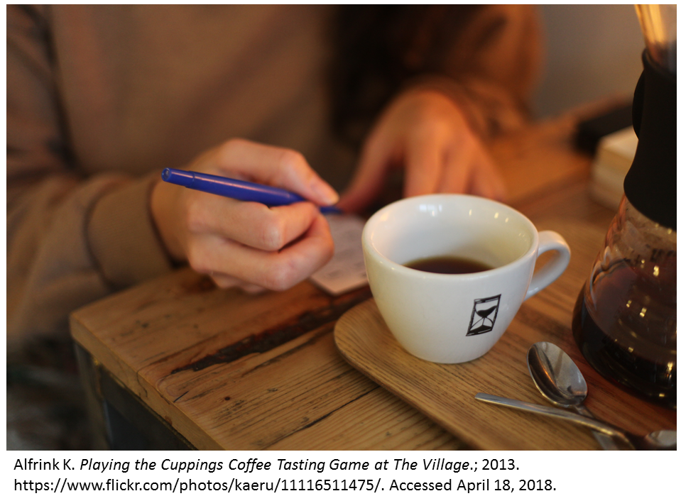 A zoomed in photo shows a woman's hands writing next to a coffee cup.