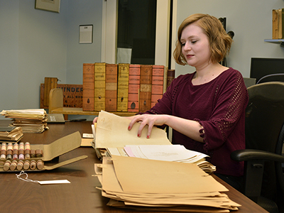 archivist Nicole Topich processes materials (2017)