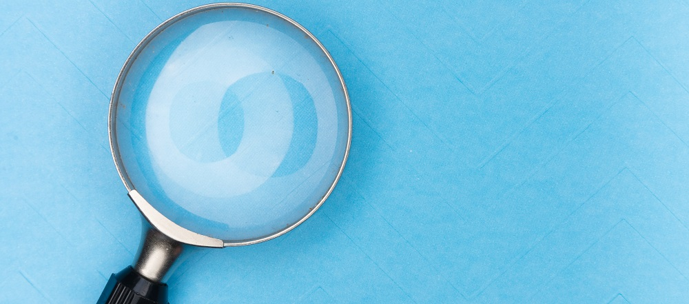 Magnifying glass to represent research