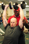 Photo: Civilian personal trainer helps military members reach their goals