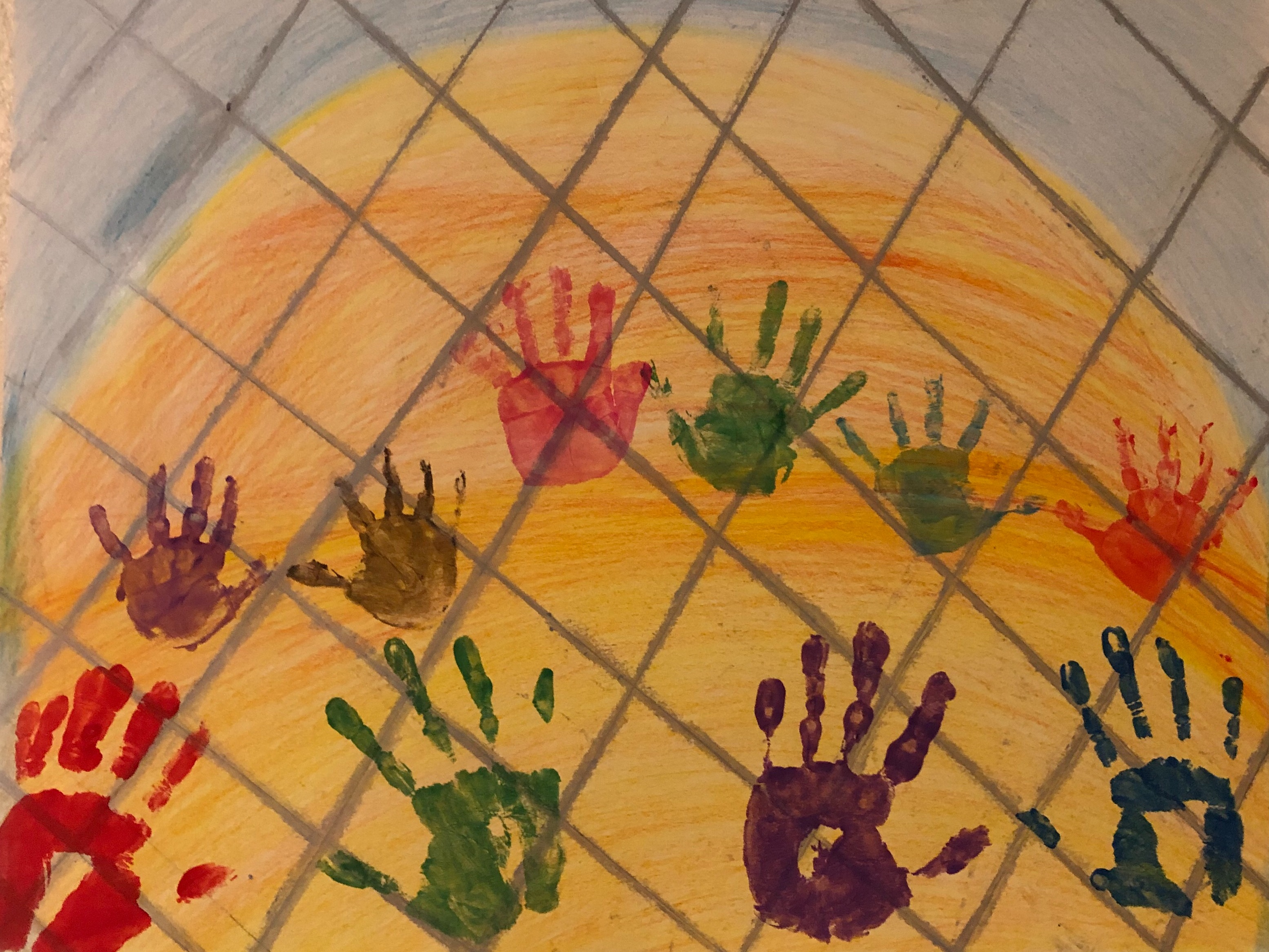 Painting/collage made w/crayon, fingerpaint, and color pencil depicting the hands of child detainees at the southern border