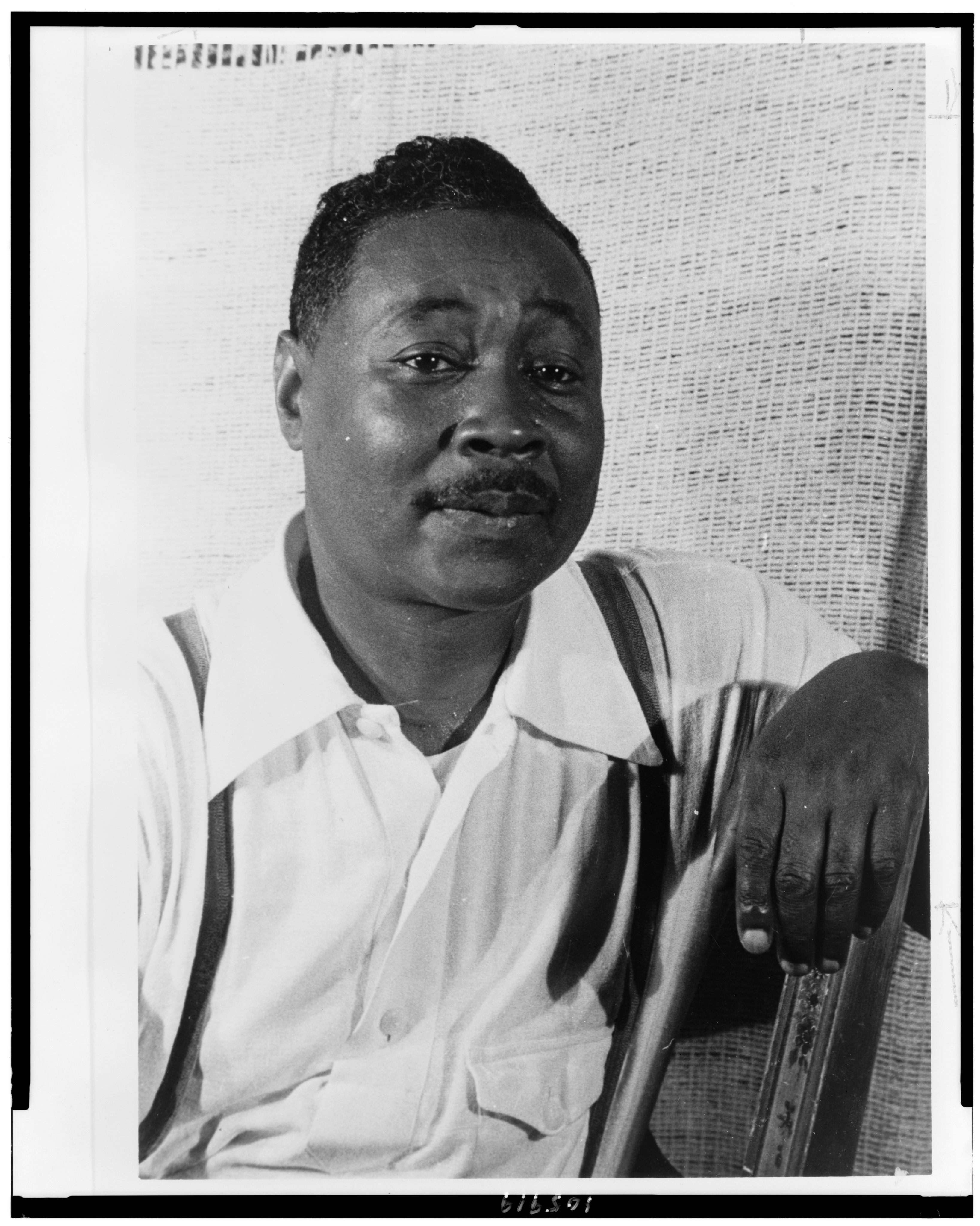 Claude McKay, half-length portrait, facing right