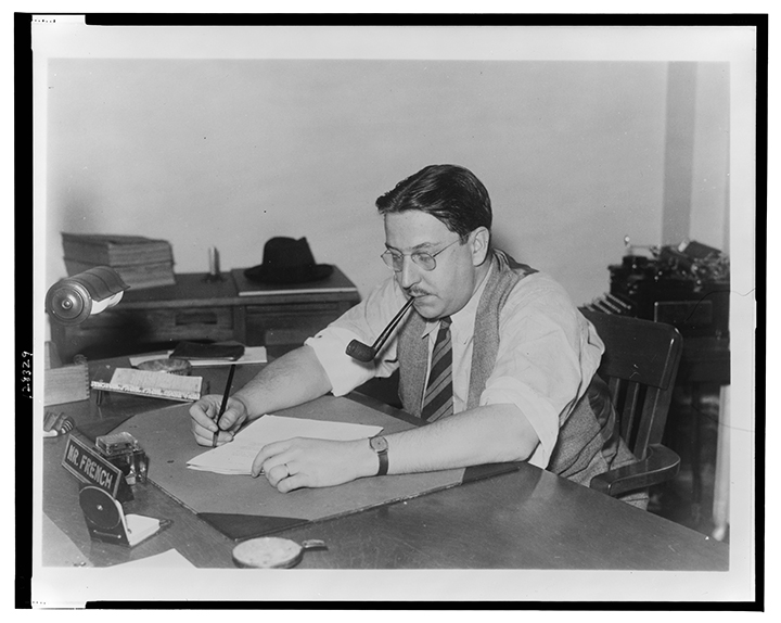 Paul Comly French, State Director of the Pennsylvania Unit, W.P.A. Federal Writers' Project, half-length portrait, seated at desk, writing, facing left, smoke pipe in his mouth
