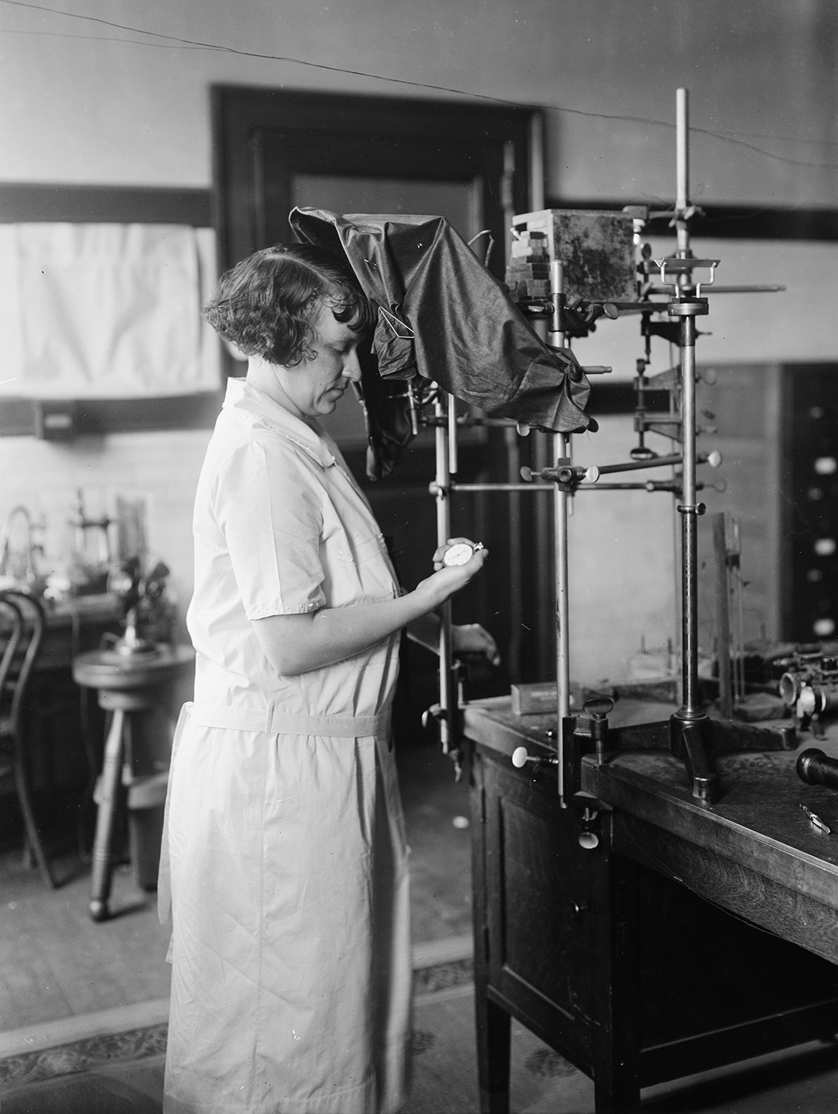 A woman operates equipment at the Bureau of Standards