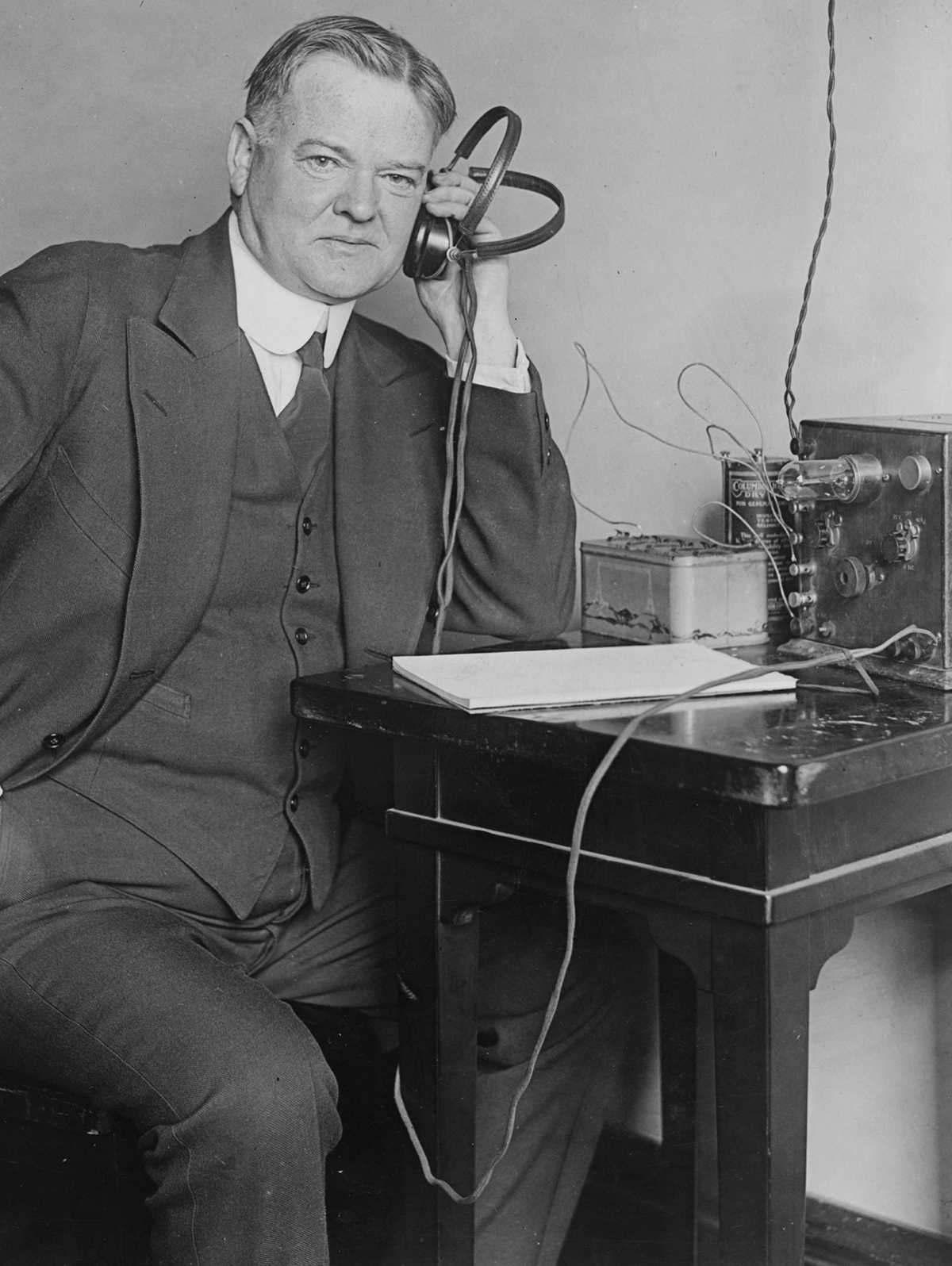 Hoover listens to a radio