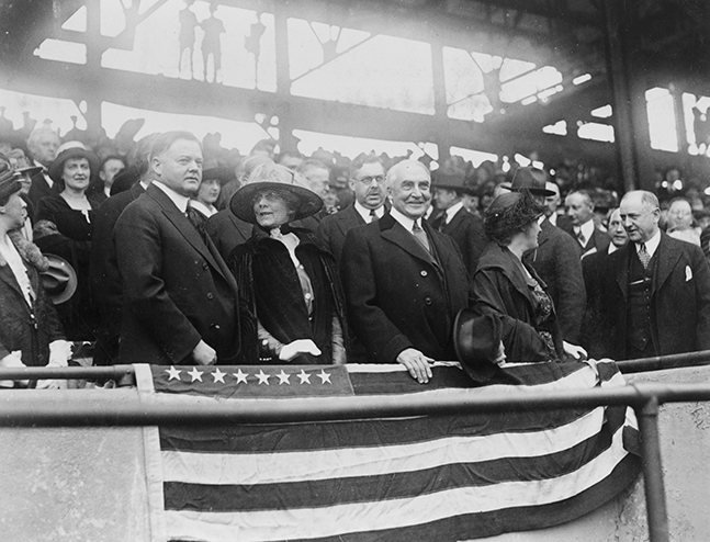 Hoover and his wife Lou appear at a baseball game with the President Harding and First Lady Florence Harding