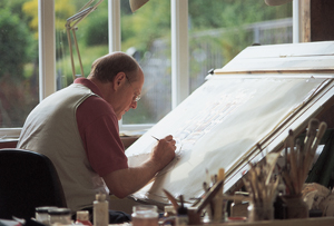 Photograph of a restorer working on artwork at an easel