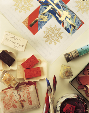 Photograph of artist materials, paints, brushes and stamps