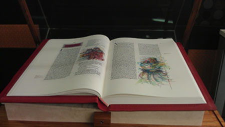 Photograph of one of the bible volumes open on display
