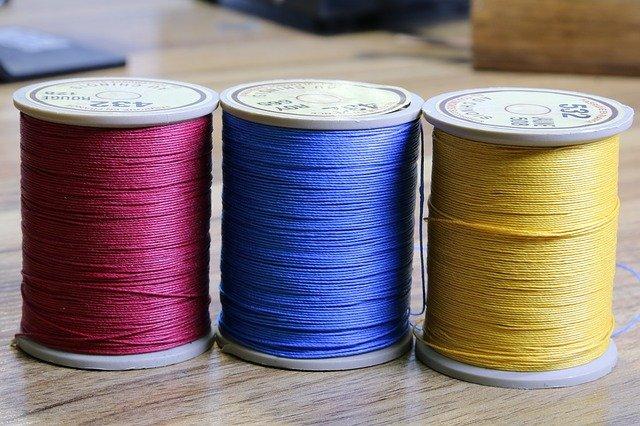 Three spools of thread