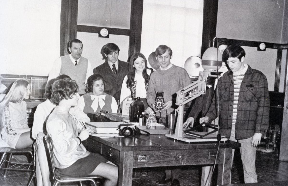 Students in a photography class learning about the equipment, circa 1965-1970.