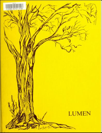 Yellow yearbook cover with tree