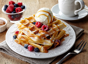 Waffles with berries and ice cream.