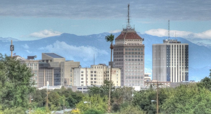 Downtown Fresno with mountains in background.