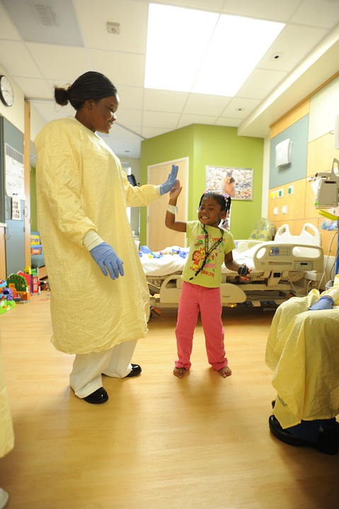 nurse and child in hospital