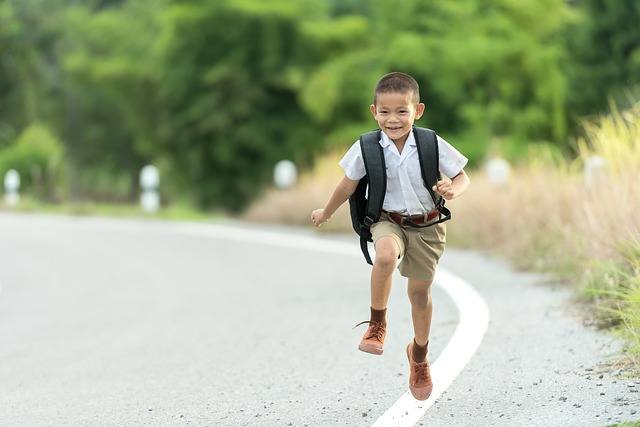 Smiling child running down the road.