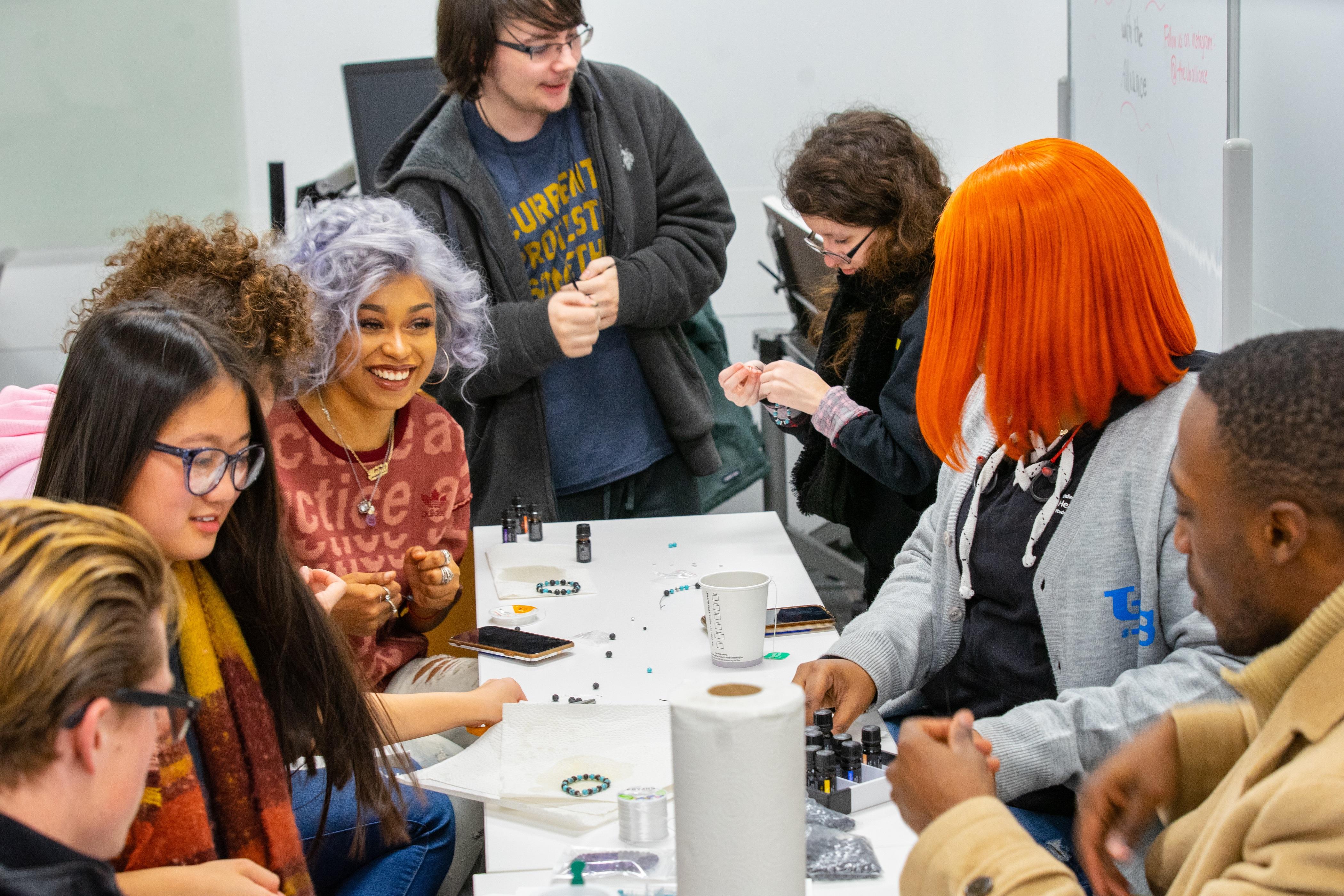 Students making aromatherapy bracelets