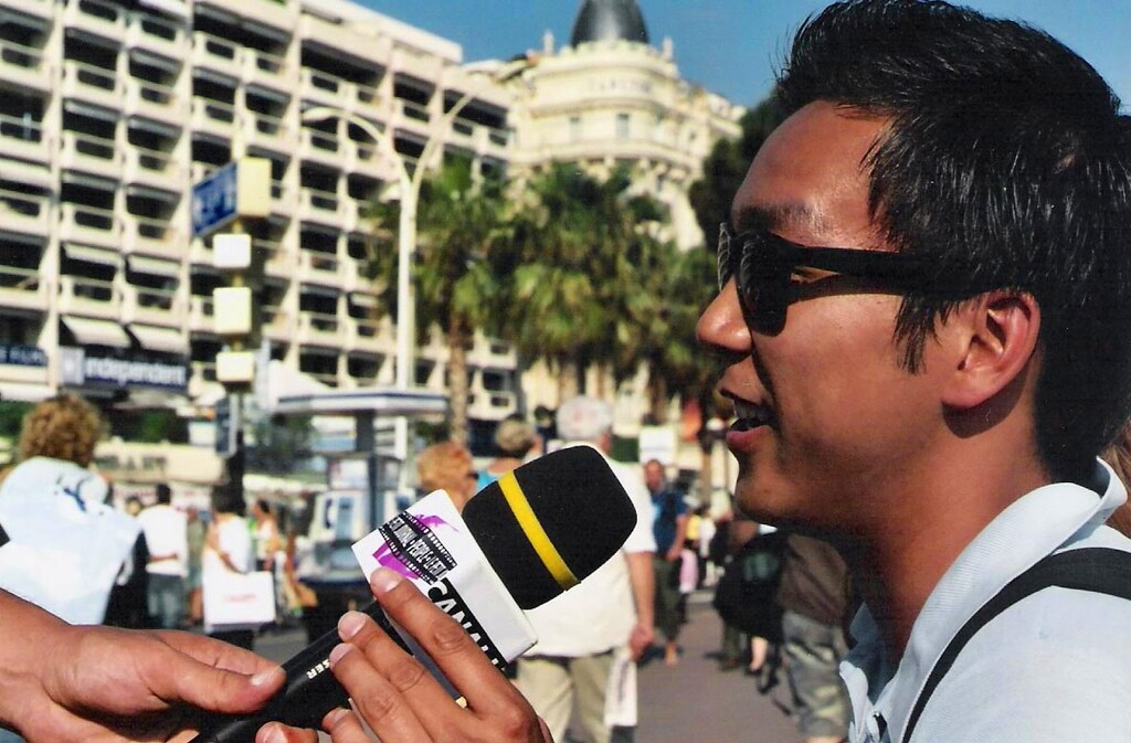 A photograph of a first hand interview with a man in Cannes.
