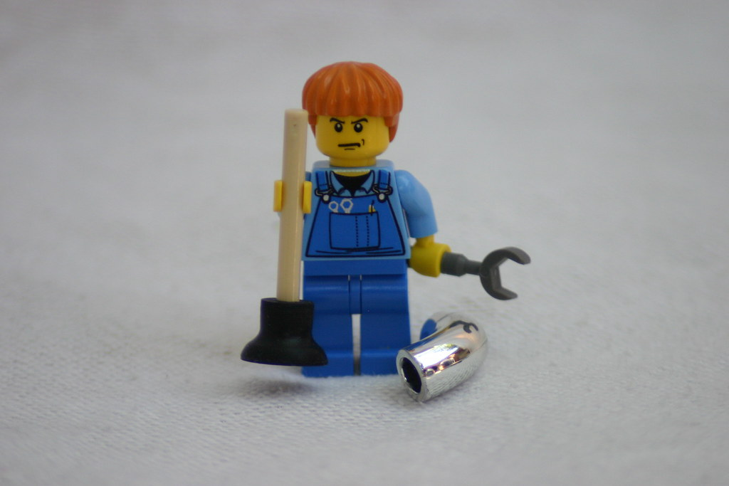 A photograph of a lego person dressed as a plumber
