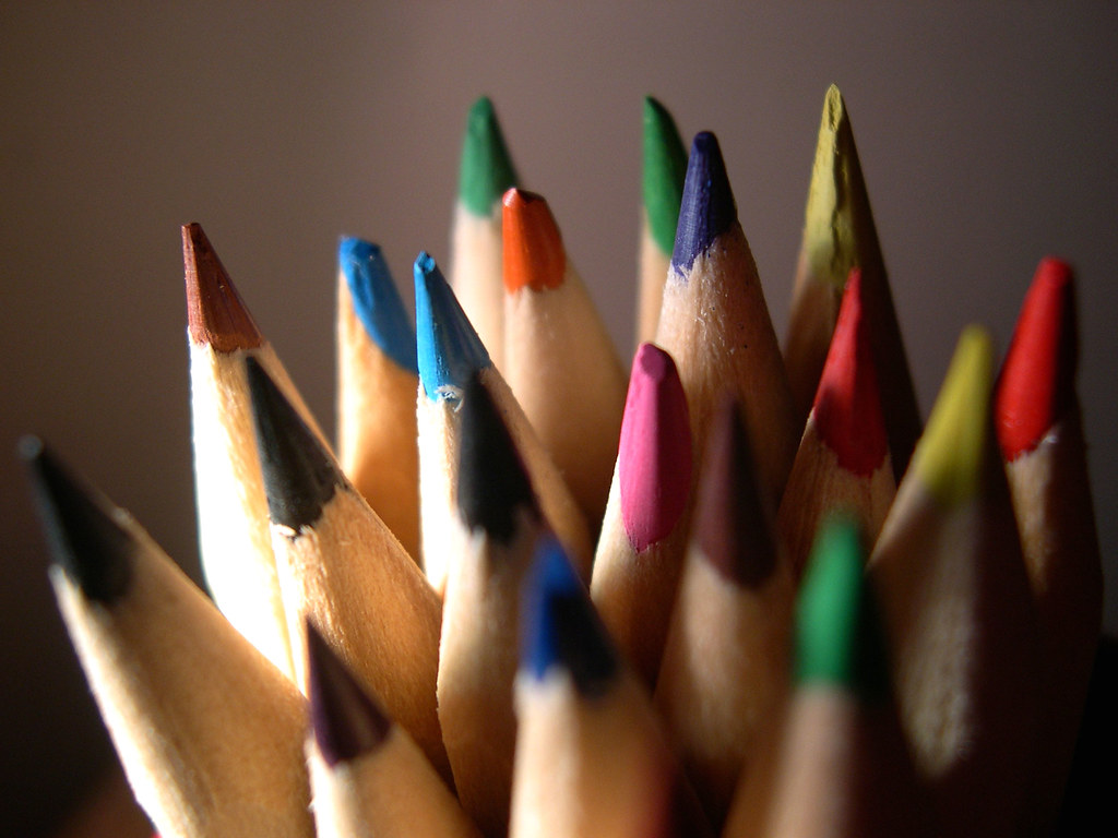 A photograph of multiple colored pencils at their tips