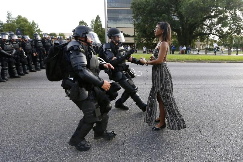 Protestor Ieshia Evans is detained by law enforcement near the headquarters of the Baton Rouge Police Department in Baton Rouge, Louisiana, U.S. July 9, 2016.