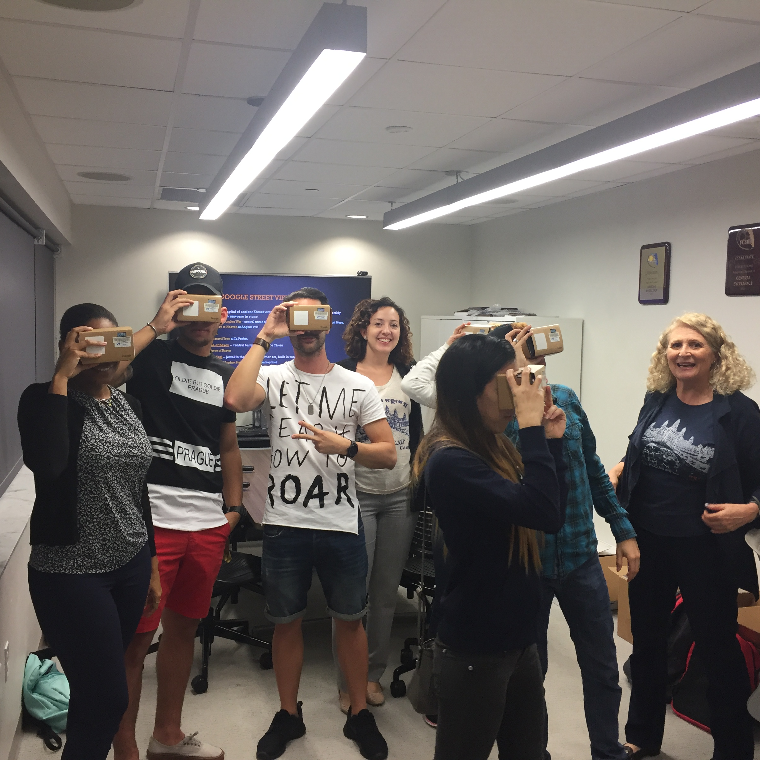 Students using Google Cardboard VR to visit Cambodia