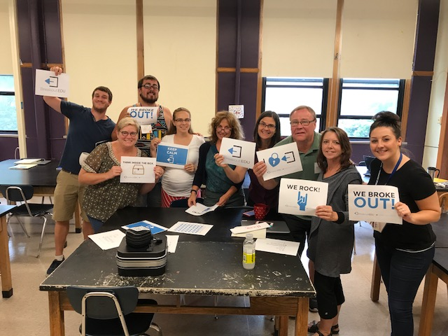 6th grade staff breaking out with BreakoutEDU
