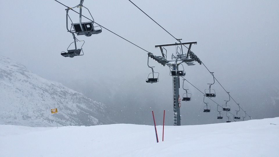 Chair lifts on a snowy mountainside
