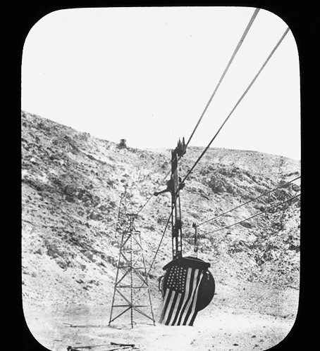 Carrier draped with American flag, Saline Valley tram