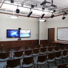 Photo of chairs and projector in the Program Room.